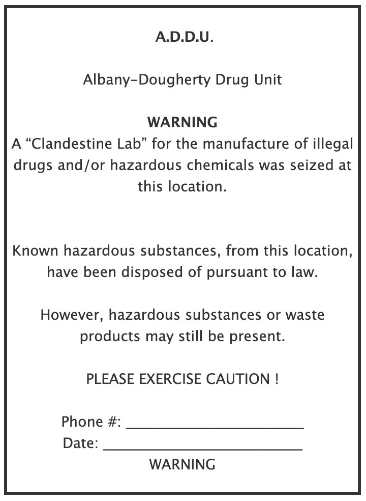 ADDU Warning Sign - A Clandestine Lab for the manufacture of illegal drugs and or hazardous chemicals was seized at this location.