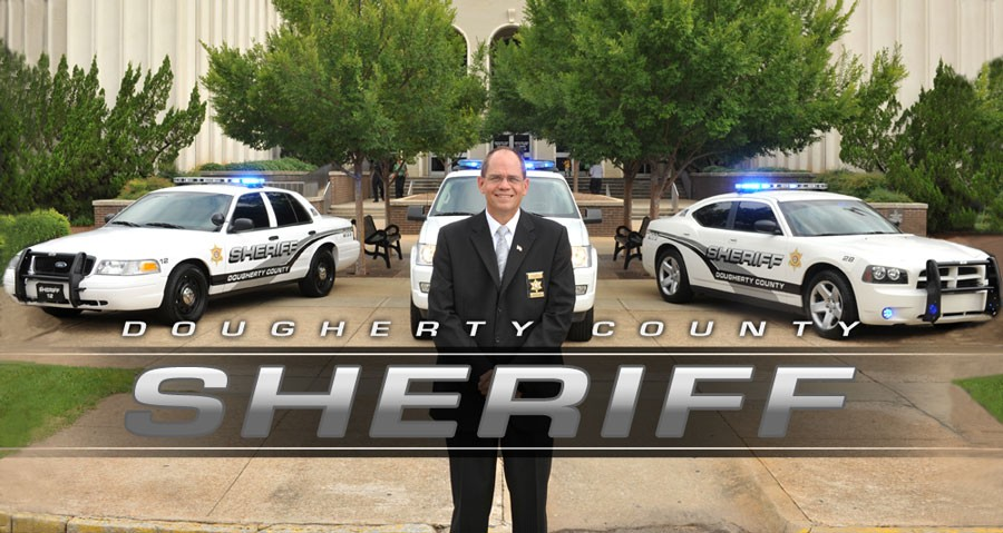 Dougherty County Sheriff standing in front of police cars