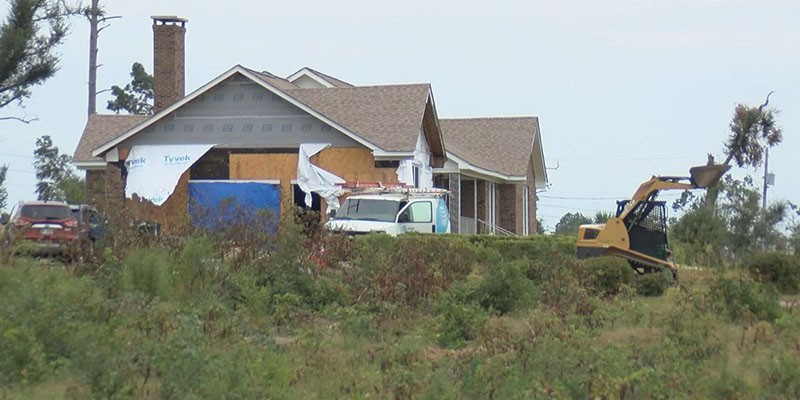 House with severe damage and siding missing