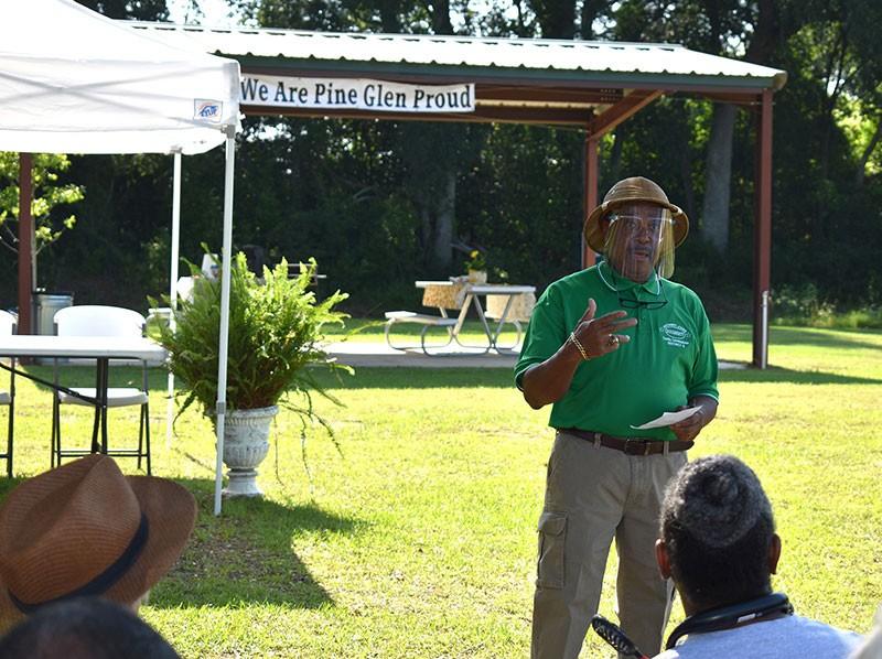 Man gives speech at event.